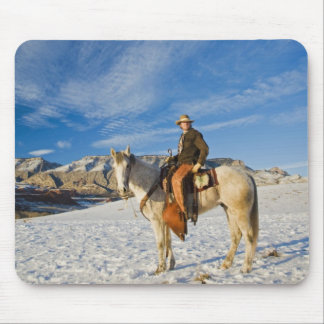 Cowboy on his Horse in the Snow 2 Mouse Pad