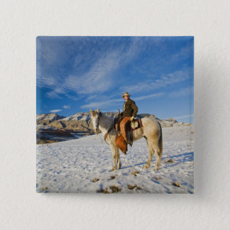Cowboy on his Horse in the Snow 2 Pinback Button