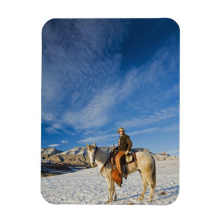 Cowboy on his Horse in the Snow 2 Vinyl Magnet
