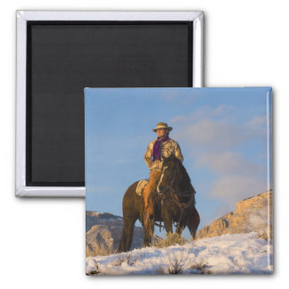 Cowboy on his Horse in the Snow Fridge Magnet