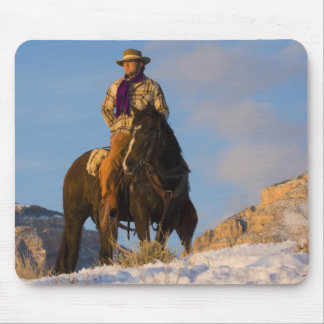 Cowboy on his Horse in the Snow Mouse Pad
