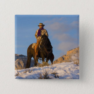 Cowboy on his Horse in the Snow Pinback Button