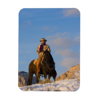 Cowboy on his Horse in the Snow Vinyl Magnets