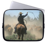 Cowboy on horse with lasso driving cattle laptop sleeves