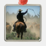 Cowboy on horse with lasso driving cattle christmas ornaments