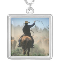 Cowboy on horse with lasso driving cattle silver plated necklace