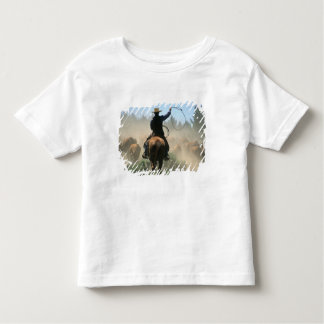 Cowboy on horse with lasso driving cattle toddler t-shirt