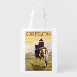 Cowboy on Horseback Vintage Travel Poster Grocery Bag