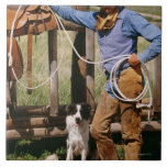 Cowboy posing with lasso and pet dog large square tile