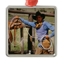 Cowboy posing with lasso and pet dog metal ornament