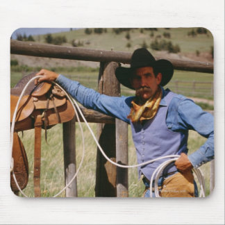 Cowboy posing with lasso and pet dog mouse pads
