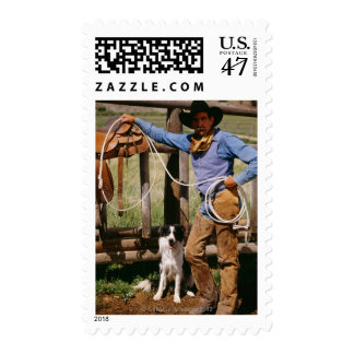 Cowboy posing with lasso and pet dog postage