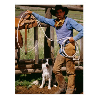 Cowboy posing with lasso and pet dog postcard