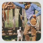 Cowboy posing with lasso and pet dog square sticker