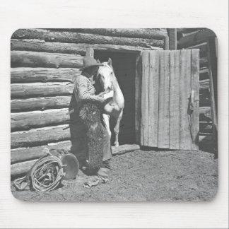 Cowboy reading a letter mouse pad