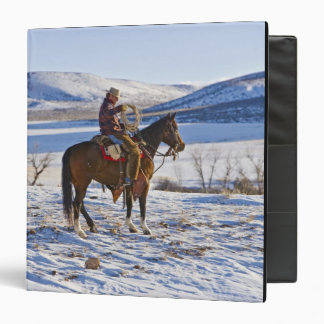 Cowboy riding a horse on the range on The 3 Ring Binder