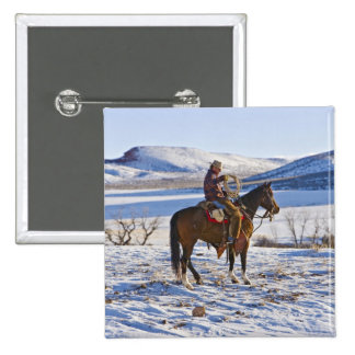 Cowboy riding a horse on the range on The 2 Inch Square Button