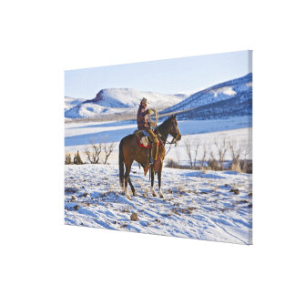 Cowboy riding a horse on the range on The Canvas Print
