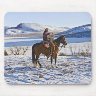 Cowboy riding a horse on the range on The Mouse Pad