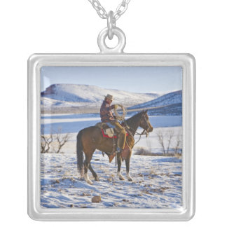 Cowboy riding a horse on the range on The Square Pendant Necklace