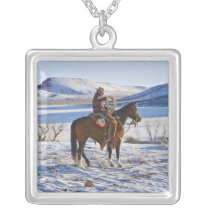 Cowboy riding a horse on the range on The Silver Plated Necklace