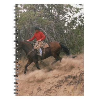 Cowboy riding downhill notebook