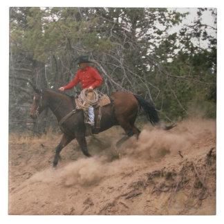Cowboy riding downhill ceramic tile