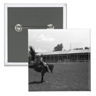 Cowboy riding horse in rodeo, (B&W) 2 Inch Square Button