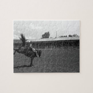 Cowboy riding horse in rodeo, (B&W) Jigsaw Puzzle
