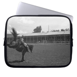 Cowboy riding horse in rodeo, (B&W) Laptop Sleeves
