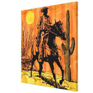 Cowboy riding horseback in desert canvas print