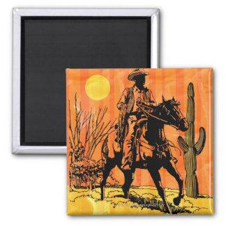 Cowboy riding horseback in desert magnet
