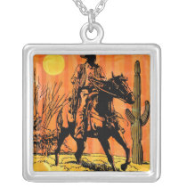 Cowboy riding horseback in desert silver plated necklace