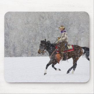 Cowboy riding in snowfall mouse pad