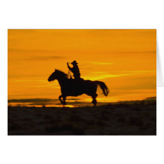 Cowboy riding in the Sunset with lariat Rope 2 Card