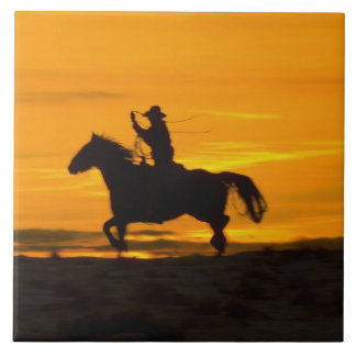 Cowboy riding in the Sunset with lariat Rope 2 Ceramic Tile