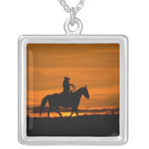 Cowboy riding in the Sunset with lariat Rope Silver Plated Necklace