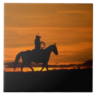 Cowboy riding in the Sunset with lariat Rope Tile