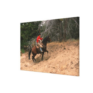Cowboy riding uphill canvas print