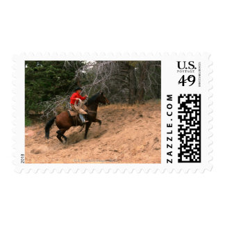 Cowboy riding uphill postage stamps