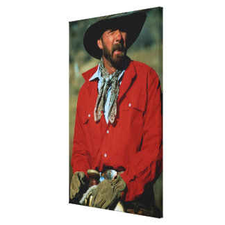 Cowboy sitting on horse wearing red shirt, canvas print