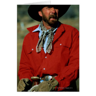 Cowboy sitting on horse wearing red shirt, card