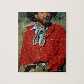 Cowboy sitting on horse wearing red shirt, jigsaw puzzle