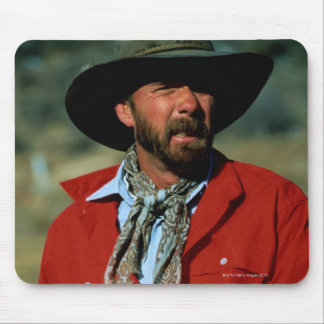 Cowboy sitting on horse wearing red shirt, mouse pad