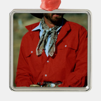 Cowboy sitting on horse wearing red shirt, christmas tree ornament