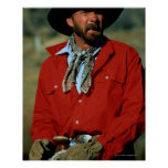 Cowboy sitting on horse wearing red shirt, poster