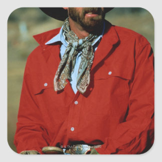 Cowboy sitting on horse wearing red shirt, square sticker