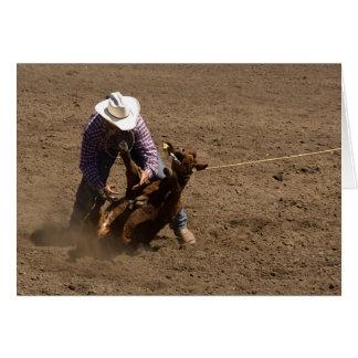 Cowboy ties a calf greeting card