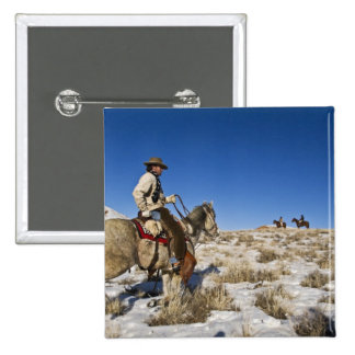 Cowboy with horses on the range on The Hideout Button