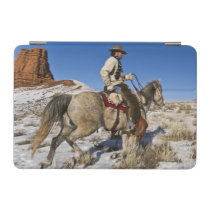 Cowboy with horses on the range on The Hideout iPad Mini Cover